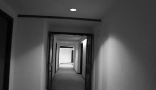 depositphotos_70900917-Walking-down-a-hotel-corridor