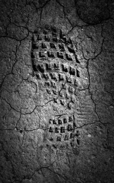 29206020-forgotten-footprint-in-the-moonlight-a-abstract-image-of-a-black-and-white-image-of-a-boot-print-in-
