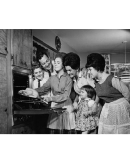 teenage-girl-putting-a-turkey-into-an-oven-with-her-family-standing-beside-her-canvas-art-24-x-36.jpeg