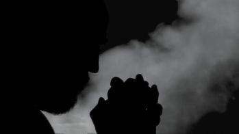 silhouette-man-praying-smoke-a-man-praying-god-with-a-rosary-in-his-old-wrinkled-hands-whispering-words-of-faith-and-devotion-dark-silhouette-over-thick-grey-smoke-rising_4kyntj7r__F0000